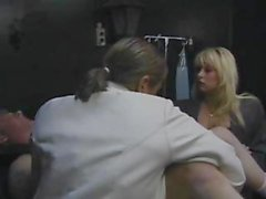 Dude gets tied up for his exam as this blonde babe checks him out