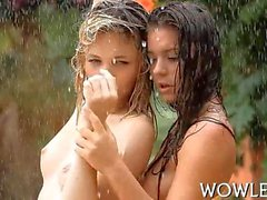 Wet teen beauties fool around outside