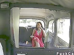 Busty Brith upskirt in back seat in cab