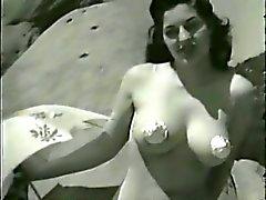 Ombrello e degli alti talloni passo di danza Sulla Sabbia