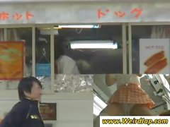 Asian waitress is giving upskirt panty shots while at work