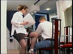 Sluty brunette secretary in black stockings doing blowjob