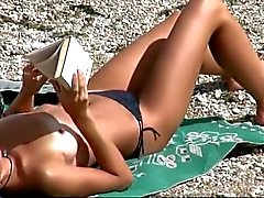 Slim teen with perky tits naked at a nudist beach