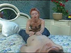the young boy breaks the ass of the mature woman.