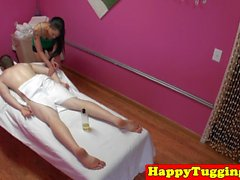 Tattooed asian masseuse jerking before sex