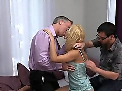 Husband sharing blonde wife with friend