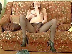 Smoking hot Kleo is masturbating her crotch on the sofa