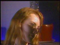 Redhead slave licking mistress' breasts