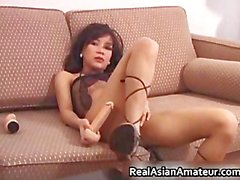 Foxy asian babe dildoing her slippery part5