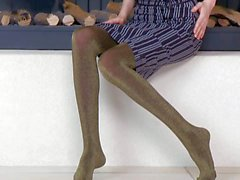 Leggy cutie Gloria in pantyhose poses by the fireplace
