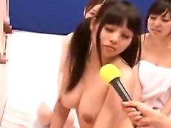 Pigtailed Oriental cutie with big breasts reveals her blowj