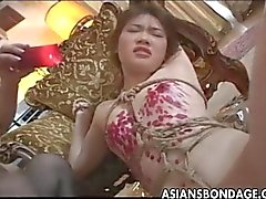 Naughty Asian babe tied up and drenched in ho