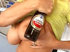 Blonde milf teasing with bottle of bear between huge knockers