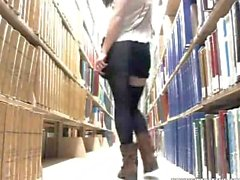 asian girl teasing and fingering in a public libary