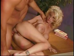 Slutty blonde gets some anal sex on the office desk from a stallion