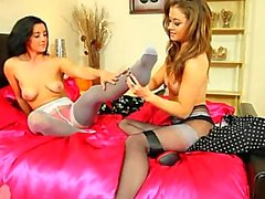 Two brunette lezzies undress in nylons