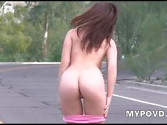 Teen masturbates in the middle of the road