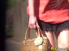 Kinky teens pee outdoors