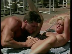 Randy slut gets jizzed by the pool after sucking cock and getting fucked