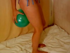 Fitness girl blow up ballon with legs