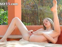 Fingering rawboned pussy on the terrace
