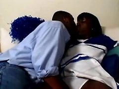 Horny black cheerleader slips out of her uniform to blow and fuck her ghetto stud