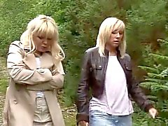 2 matures give hand-blowjob to a stranger in the woods