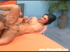 Barefoot brunette performs sexual favors