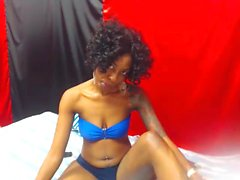 Seductive ebony beauty plays with her tablet in her underwe