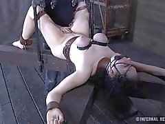 Clamped up angel receives her fuck holes tortured