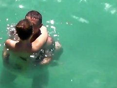 Mature wife on the beach carressing dick of her husband