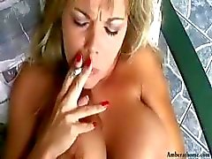 Busty blonde Amber smokes while getting her pussy licked and then gets nailed