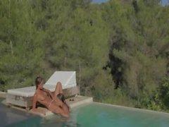 Brunette girl4girl make love in the pool