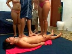 2 Mistress and 2 Masters trample slave girl
