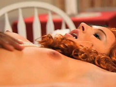Ashli Orion wear a curly red wig and always tries to...