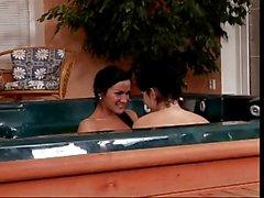 Hot lesbians fucking in a hot tub