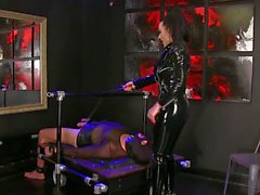 Femdomlady shiny latex and licking male slave