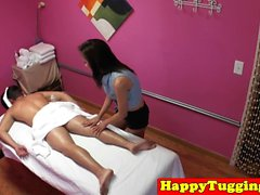 Smalltitted asian masseuse jerking her client