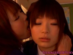 Japanese schoolgirls make out in classroom