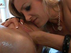 Blonde haired babe fist fucks her lesbian lover