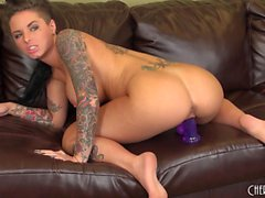 Tattooed Christy Mack toys her twat and poses showing her great tits