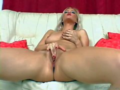 glamorous blonde beauty plays with glass toy in close up