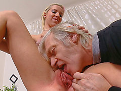 An old fart copulates glamorous blond honey on the table after licking her love tunnel