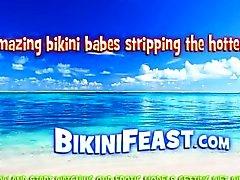 Blonde beach diva in wet bikini