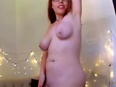 Fetish redhead toys her pussy