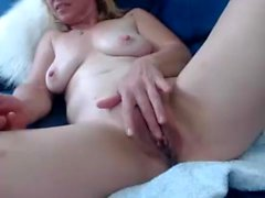 Solo blonde rubs her cunt close up