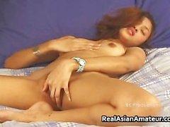 Teen asian shoves a huge dildo into her part1