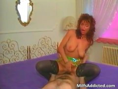 Redhead MILF blows hard cock and gets