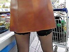 Black stockings upskirt in supermarket 2