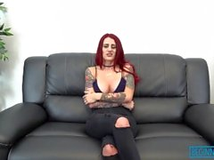 Naughty redhead gets hammered on a leather couch